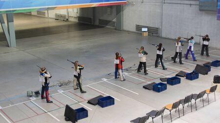 6-12-2019 RUSSIA, KAZAN: BULLET SHOOTING - young women in the shooting gallery