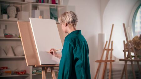 A young woman sketching on the canvas