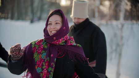 Russian folklore - russian people dancing outdoors at winter