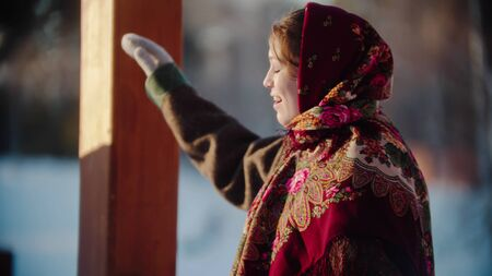 Russian folklore - Russian woman smiling standing outdoors - outdoor Stok Fotoğraf