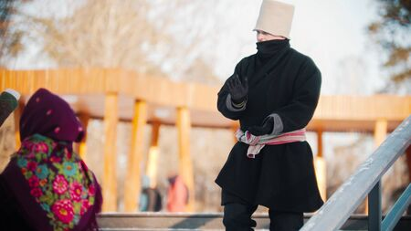 Russian folklore - man dancing on the stairs and clapping with his hands - outdoor