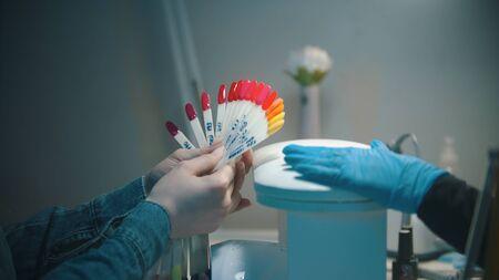 Choosing the color of nail polish on the samples Reklamní fotografie