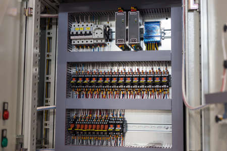 Making an electricity panel board on the plant - the inside of the panel - slots and wires