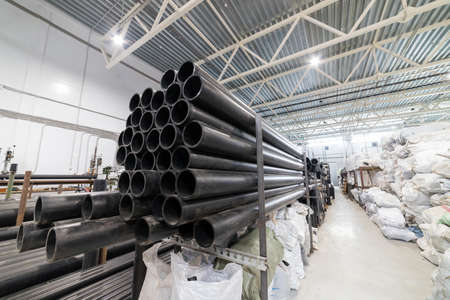 Black plastic tubes in the manufacturing centre