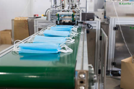 Production of medical masks - masks on the production bend