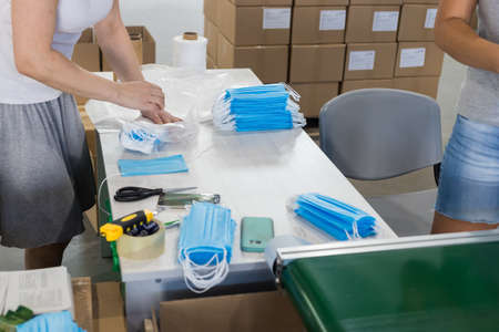 Industrial production of medical masks and packing in boxes