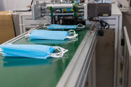 Industrial production of medical masks - masks on the production bend