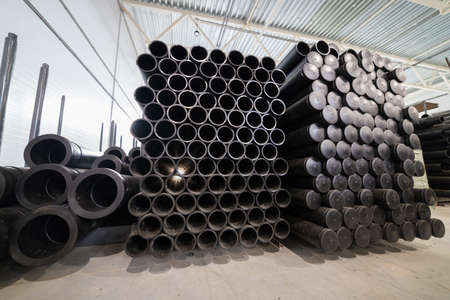 Black plastic tubes in the manufacturing storage