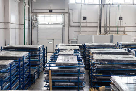 Modern warehouse filled with plastic windows packed in polyethylene