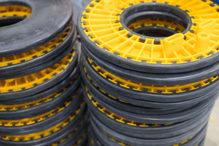 Yellow and grey blocks for wires in the manufacturing centre Banque d'images