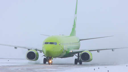 10-02-2021 KAZAN, RUSSIA, Kazan International Airport : a big plane from S7 AIRLINES campaign on the runway field