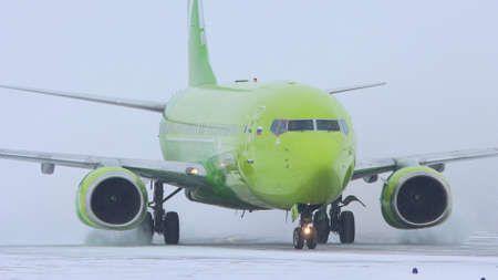 10-02-2021 KAZAN, RUSSIA, Kazan International Airport : a big green plane from S7 AIRLINES campaign on the field Editorial