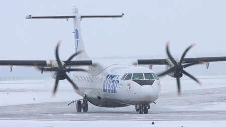 10-02-2021 KAZAN, RUSSIA, Kazan International Airport : a white plane from UTAIR campaign