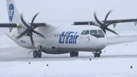 10-02-2021 KAZAN, RUSSIA, Kazan International Airport : a white plane from UTAIR campaign with large valves Editorial