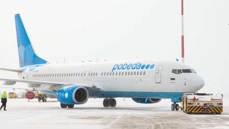 10-02-2021 KAZAN, RUSSIA, Kazan International Airport : a white plane from POBEDA campaign