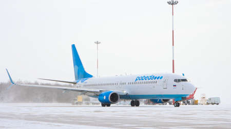 10-02-2021 KAZAN, RUSSIA, Kazan International Airport : a white and blue plane from POBEDA campaign on airport field