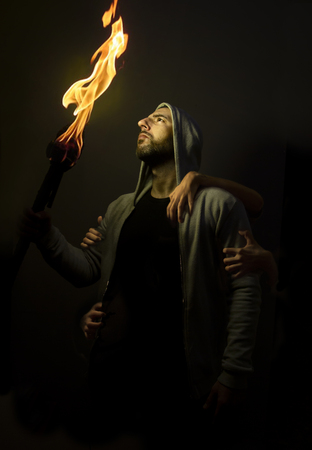 Boy with fire Stock Photo
