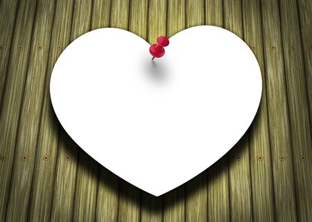 A paper heart, pinned on a wood panel background  Stock Photo