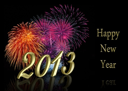 Golden New Year 2013 with a colourful firework display on a black background  Stock Photo