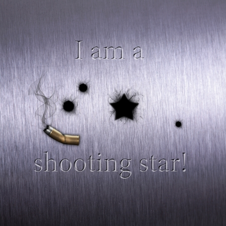 Humorous shot illustration on brushed metal  Bullet holes - one looks like a star - together with a damaged and smoky cartridge case and the text  I am a shooting star