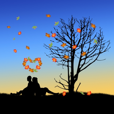 heart under: Autumn Love  A couple sitting in the grass next to a tree under a heart of leaves
