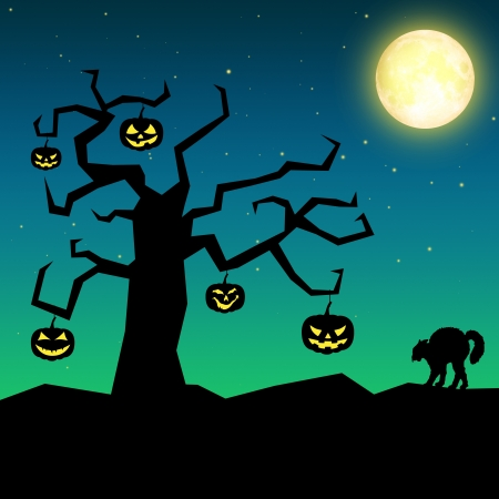 Halloween pumpkins hanging from the branches of a bare tree