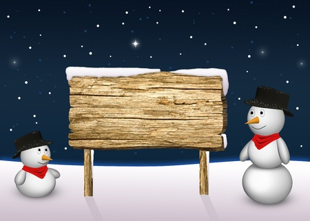 2 cute snowmen are looking to a blank wooden sign in a snowy winter scene  Stock Photo