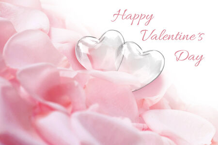 Elegant and lovely illustration  two glass hearts on a bed of white-pink rose petals with Valentine greeting