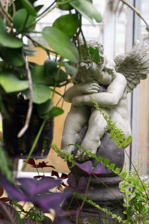 Cupid  is the god of desire, erotic love, attraction and affection  photo