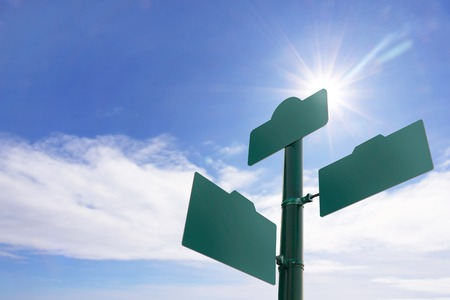 Blank Green street sign  on blue sky background Stock Photo