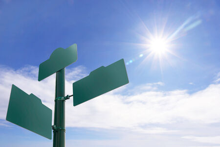 signboard: Blank Green street sign  on blue sky background Stock Photo