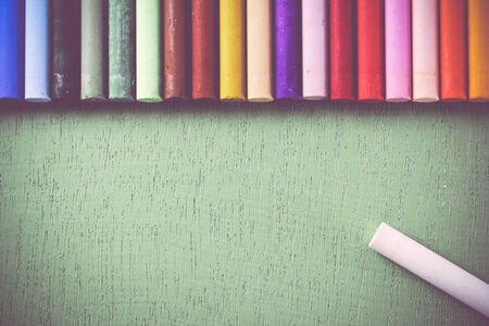 lined up: Crayons lined up in rainbow isolated on green , soft color, retro color Stock Photo