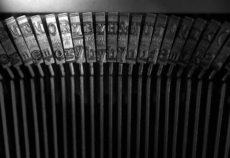 typebar: Types of an old typewriter and word  MEMORY  lighting