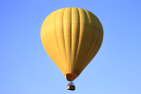 yellow hot air balloon on sky 写真素材