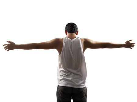 stretched out: Rear view of young man with his arms stretched out isolated on white background Stock Photo