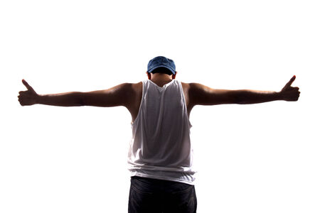 Rear view of young man with his arms stretched out isolated on white background Stock Photo