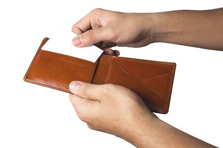 hand and taking out credit card from wallet. photo