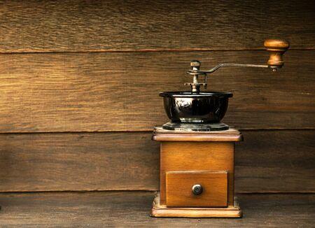 coffee grinder: Vintage Coffee grinder on wood background.