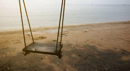 Swing wood on the beach.