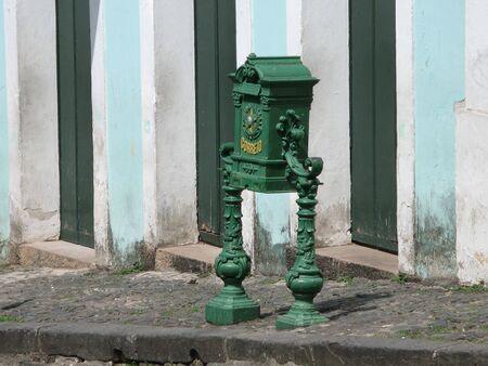 Old green iron mailbox in the historic city of Salvador de Bahia, Brazil Stock Photo