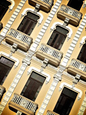 Detail of a yellow house front in Havana