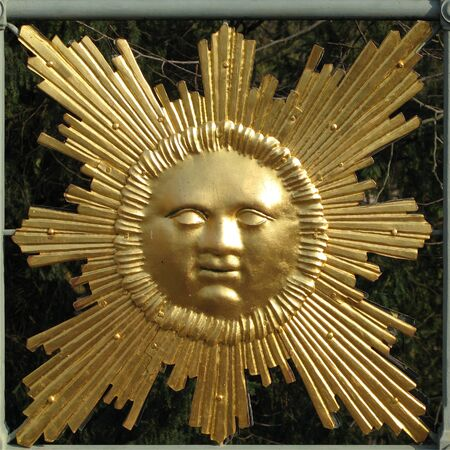 eye catcher: Sun emblem on a railing Stock Photo