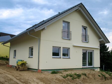 View onto a newly constructed yellow single-family house