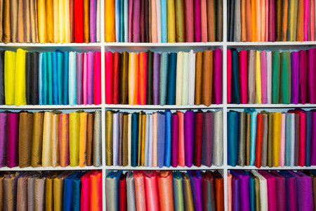 fabric roll: Shelf with a wide selection of colorful fabrics  Stock Photo
