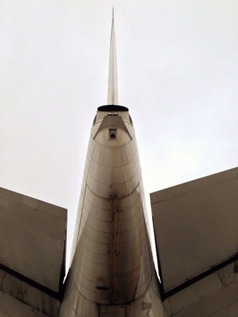 noise pollution: Empennage of a boeing 747, seen upwards against the sky