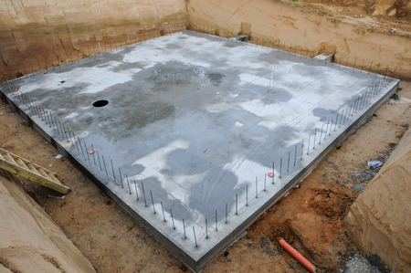 Concrete base in an excavation for a house.