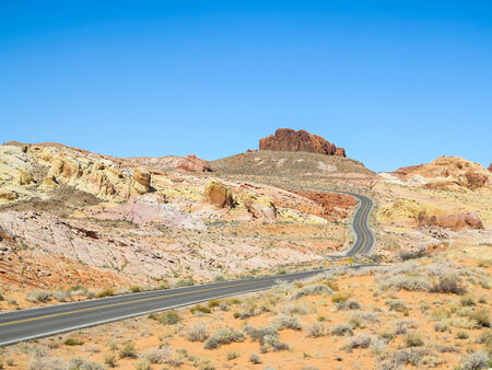 Empty asphalt road that winds through the Valley of Fire, Nevada. Stock Photo