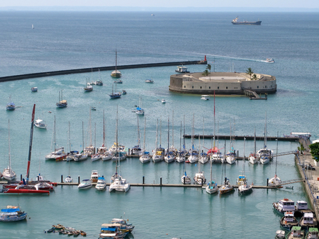 View onto the Harbor of Salvador de Bahia with a fortress and ships.