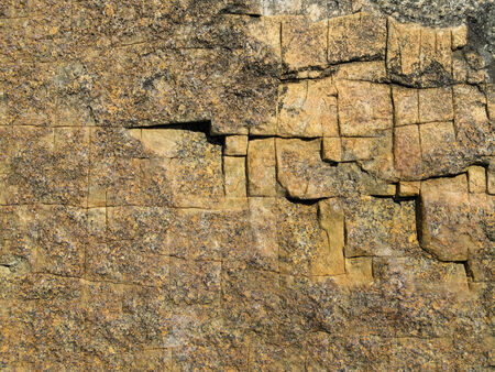 grooves: Natural rock crossed by grooves, full frame.