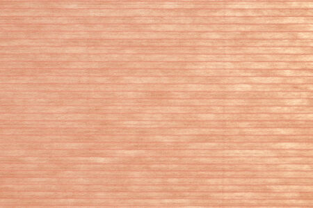 Pink lined paper background, through which some light is shimmering.